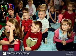 kids at a christmas party enjoying the children u0027s entertainer