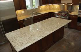 mahogany cabinets and giallo ornamental granite kitchen design