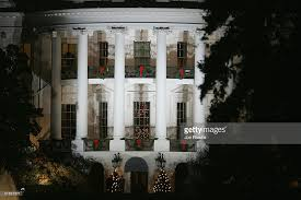president george w bush lights national tree photos and