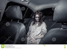 scary halloween photo background horror zombie woman with bloody face in the car stock photo