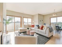 3000 raleigh avenue 407 saint louis park mn 55416 mls expansive living room with fireplace and full length windows opens onto private terrace