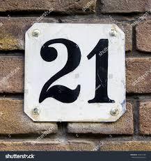 house number twentyone black lettering on stock photo 103412198