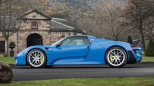 Porsche 918 Hypercar - arrow blue porsche 918 spyder weissach heads to auction