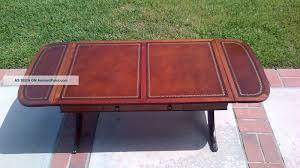 antique english leather top drop leaf coffee table with brass claw