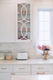 white kitchen cabinet with glass doors mullion cabinet doors how to add overlays to a glass