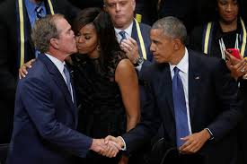 george bush kissing michelle obama while shaking hands with the
