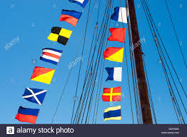 nautical flag colorful nautical sailing flags flying in the wind from the lines