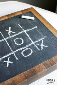 tic tac toe chalkboard butcher block hunt and host this thrifted old butcher block gets a chalkboard makeover to display a fun game of tic