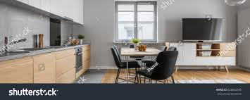 modern apartment open wood kitchen table stock photo 628832045