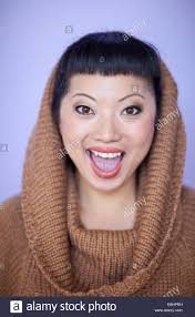 woman with short hair asian woman with warm fuzzy cowl neck sweater on short hair cut