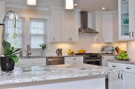 granite countertop white kitchen cabinets with white granite