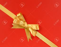 bow wrapping paper gold gift bow ribbon corner diagonal isolated on wrapping