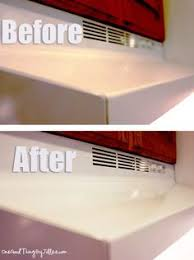 to clean white corian sink stains line sink with paper towels