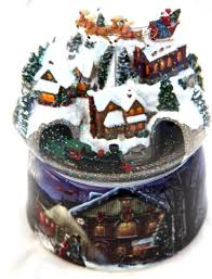 large musical snow globe with santa on a sleigh and a moving