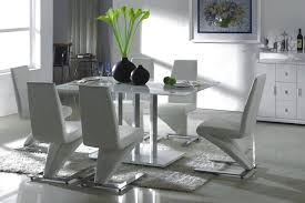 astonishing oval glassing room table surrounded by wooden chairs