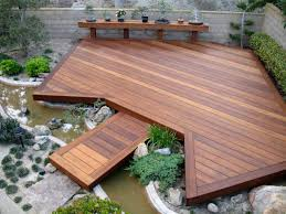 asian inspired garden with ipe decks and built in small river plus
