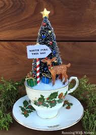teacup christmas scene north pole sign pole sign and bottlebrush