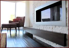 classic entertainment center with electric fireplace stone mantels