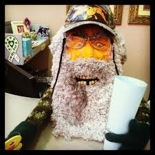 pumpkin decorated for halloween uncle si from duck dynasty