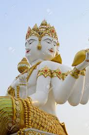 God Statue by Beautiful White Brahma Hindu God Statue In Temple Stock Photo