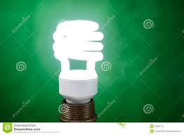 white fluorescent light bulb on green background stock photo