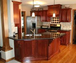 kitchen black stone countertops and white combination cabinets