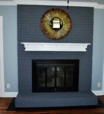 painted brick fireplace with blue paint color brick stone