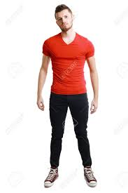 young male model posing in red shirt and black pants stock photo