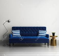 contemporary elegant luxury blue velvet sofa with striped pillows
