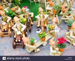 a market stall display of flowerpot wood and terracotta garden