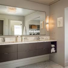 vanity lights bathroom transitional with crown molding beveled mirror
