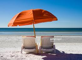 Beach Umbrella And Chairs A Setting On The Beach Of Beach Chairs And An Umbrella Stock Photo