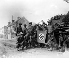 German Flag In Ww2 006 Us Soldiers Celebrate With A Captured German Flag In Front Of