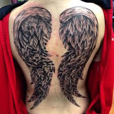black and white wings on back done by bob price at inferno studios