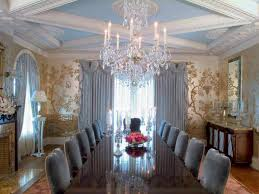 formal dining room design with crystal chandelier and wallpaper