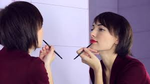 looking for makeup artist beauty woman applying makeup beautiful girl looking in the mirror
