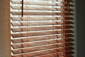 pressing on how to easily clean wood and faux wood blinds