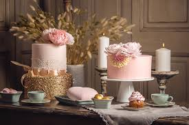 rose gold candy table luxury wedding table with a beautiful pink cake decorated with