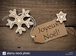 the words joyeux noël which means merry on a label