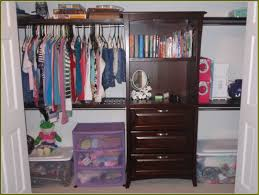 elegant bedroom with lowes closet with entire closet organizer