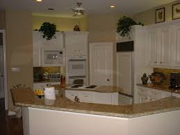 venetian gold granite countertops and tile backsplash kitchen