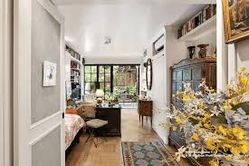 greenwich village studio with wall of windows and private backyard