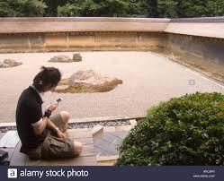 Ryoanji Rock Garden Japan Kyoto Checking Text Messages In Rock Garden Of