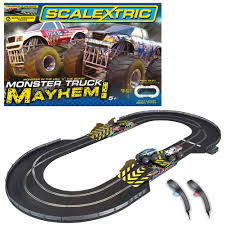videos de monster truck scalextric 1 32 scale monster truck mayhem race set amazon co uk