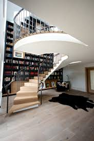 enormous staircase style incorporating a floor to ceiling bookcase