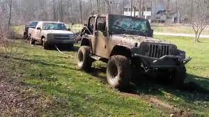 chevy jeep jeep wrangler pulls out 2 chevy trucks youtube
