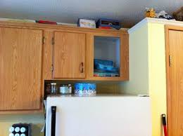 how to trim cabinet above refrigerator shorten cabinet above fridge take out or entire new cabinets