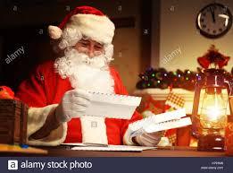 At Home Christmas Trees by Happy Santa Claus Sitting At His Room At Home Near Christmas Tree