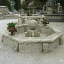 fontaine en pierre naturelle bassins