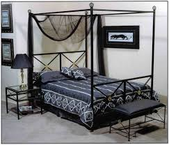bedroom black canopy bed frame made of wrought iron using black